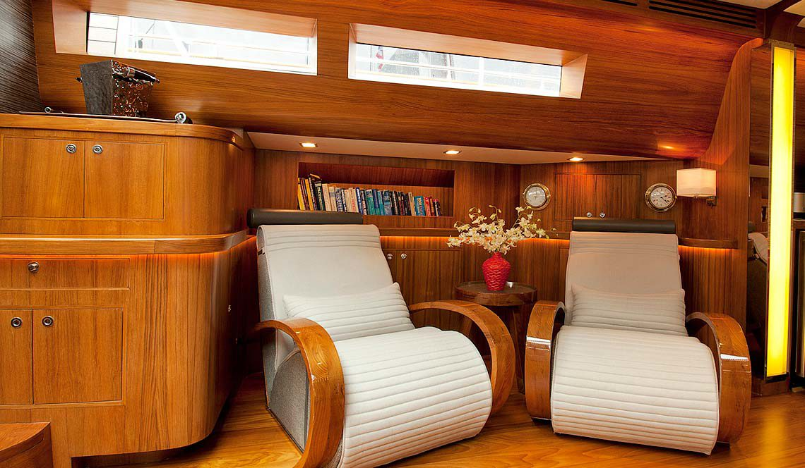 Silver Lining charter phuket saloon deck comfortable armchairs and library area